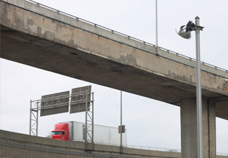 Truck Driving Under Overpass